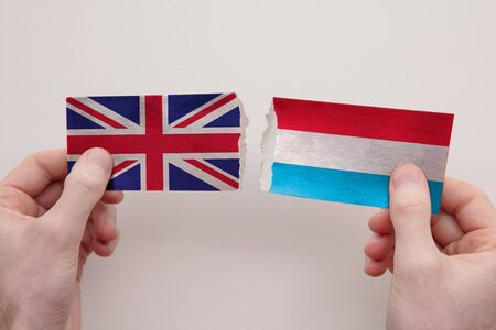UK and Luxembourg paper flags ripped apart. political relationship concept Stock fotó