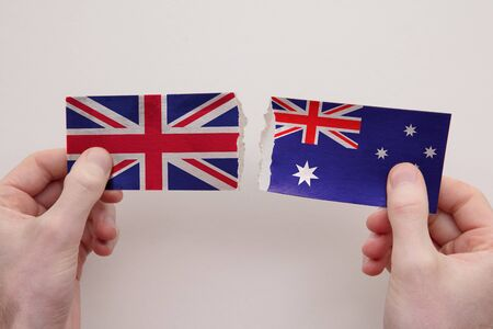 UK and Australia paper flags ripped apart. political relationship concept