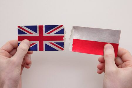 UK and Poland paper flags ripped apart. political relationship concept Stock fotó