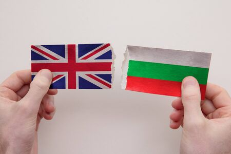 UK and Bulgaria paper flags ripped apart. political relationship concept
