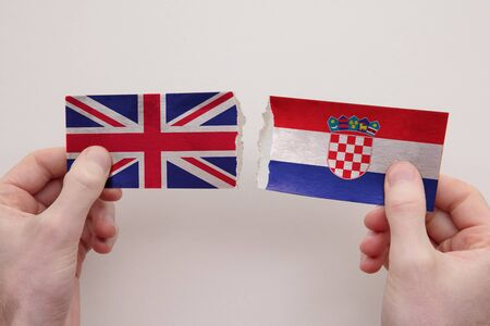UK and Croatia paper flags ripped apart. political relationship concept Stock fotó