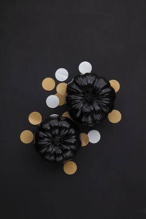 Black halloween lay flat composition with black pumpkins Stok Fotoğraf