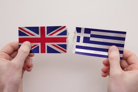 UK and Greece paper flags ripped apart. political relationship concept Stock fotó