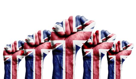 A raised fist of a protesters painted with the UK flag