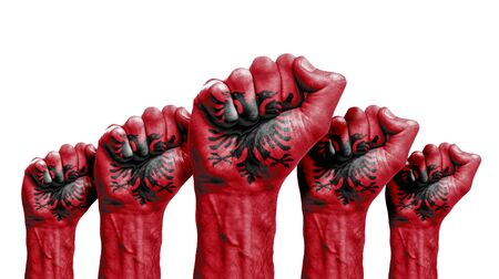 A raised fist of a protesters painted with the albania flag
