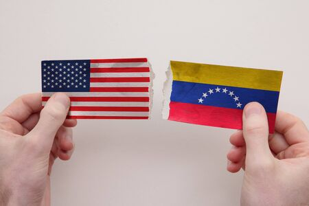 USA and Venezuela paper flags ripped apart. political relationship concept 写真素材