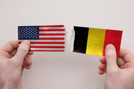 USA and Belgium paper flags ripped apart. political relationship concept 写真素材