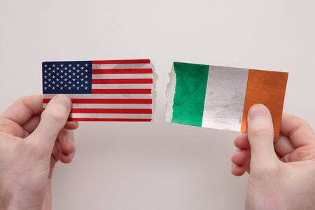 USA and Ireland paper flags ripped apart. political relationship concept 写真素材