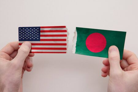USA and Bangladesh paper flags ripped apart. political relationship concept
