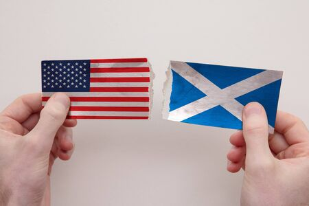 USA and Scotland paper flags ripped apart. political relationship concept 写真素材