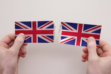 UK Union Jack paper flags ripped apart. political relationship concept