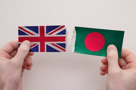 UK and Bangladesh paper flags ripped apart. political relationship concept