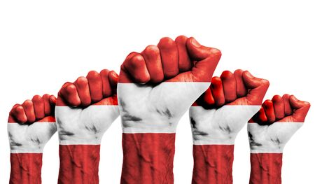 A raised fist of a protesters painted with the Austria flag Foto de archivo