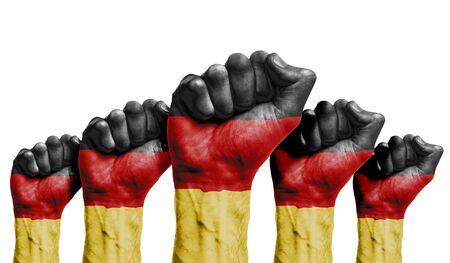 A raised fist of a protesters painted with the Germany flag