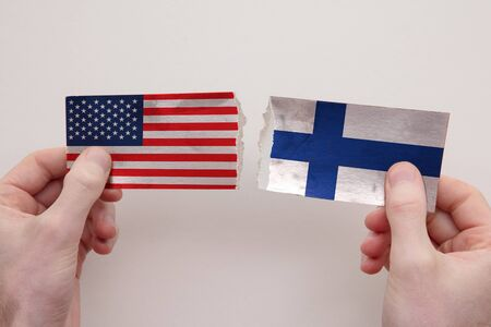 USA and Finland paper flags ripped apart. political relationship concept 写真素材