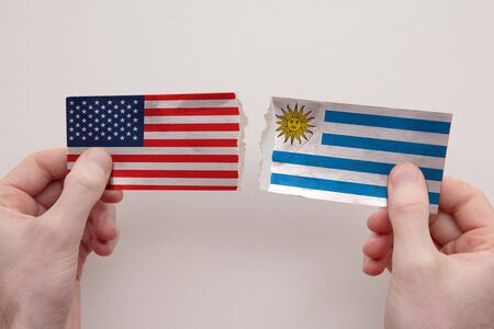 USA and Uruguay paper flags ripped apart. political relationship concept 写真素材