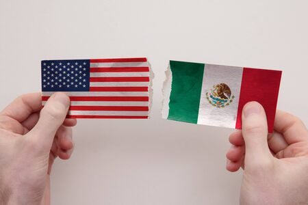 USA and Mexico paper flags ripped apart. political relationship concept