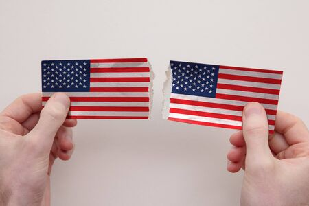USA paper flags ripped apart. political relationship concept 스톡 콘텐츠