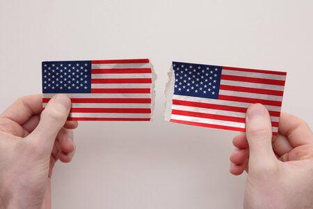 USA paper flags ripped apart. political relationship concept Foto de archivo