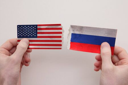 USA and Russia paper flags ripped apart. political relationship concept 写真素材