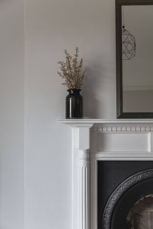 Vintage fire surround beautiful interior design Imagens - 135043820