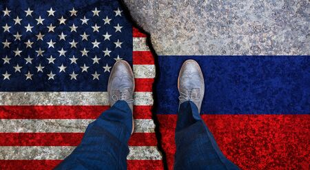 Business man stands on cracked flags of USA and Russia. Political concept Stock fotó