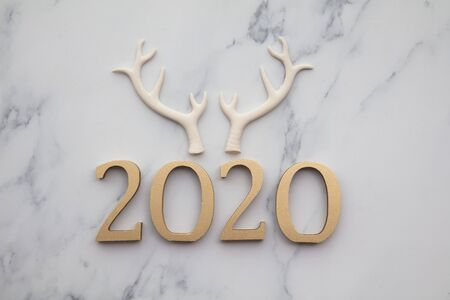 Happy new year 2020 gold number with festive reindeer antlers Stock Photo