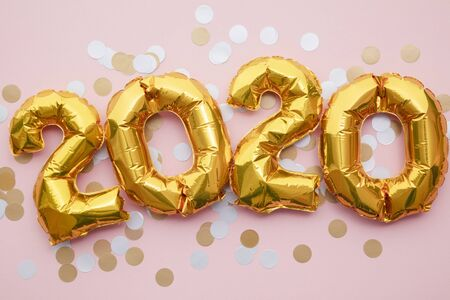 2020 New year party celebration. Gold foil party balloons with decorations