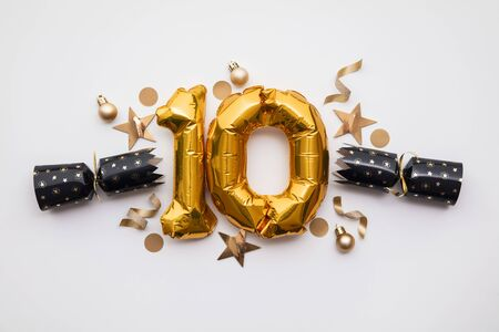 Christmas countdown. Gold number 10 with festive cristmas cracker decorations Stock Photo