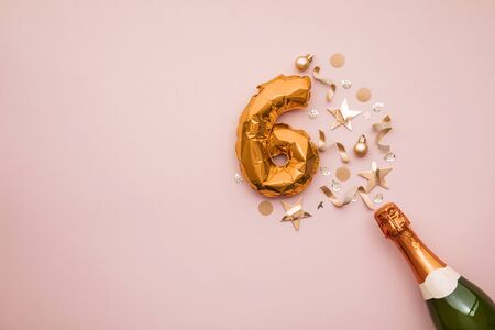 Happy 6th anniversary party. Champagne bottle with gold number balloon.
