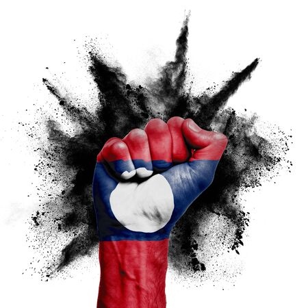 Laos raised fist with powder explosion, power, protest concept