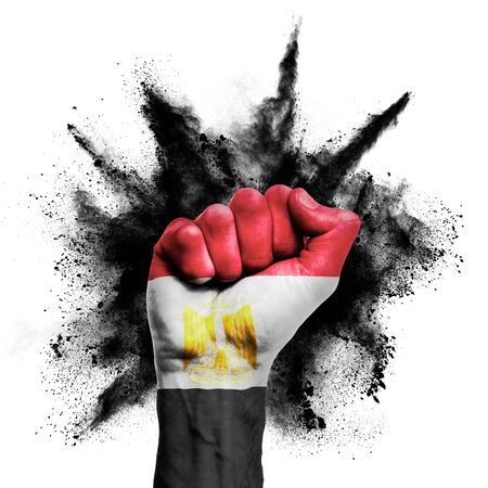 Egypt raised fist with powder explosion, power, protest concept