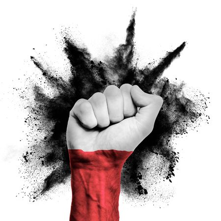 Poland raised fist with powder explosion, power, protest concept