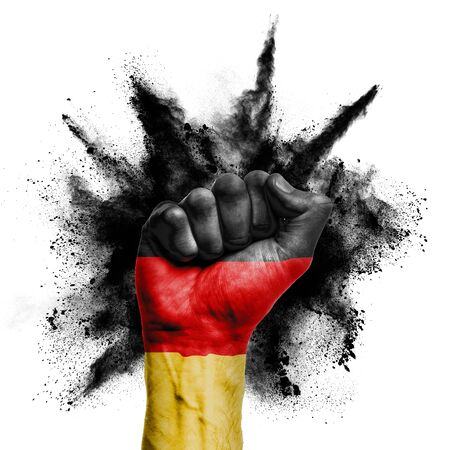 Germany raised fist with powder explosion, power, protest concept