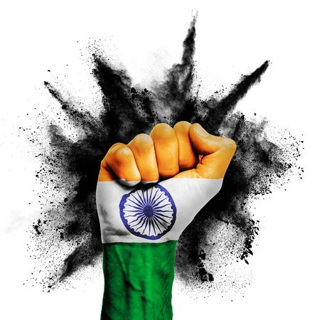 India raised fist with powder explosion, power, protest concept Banco de Imagens