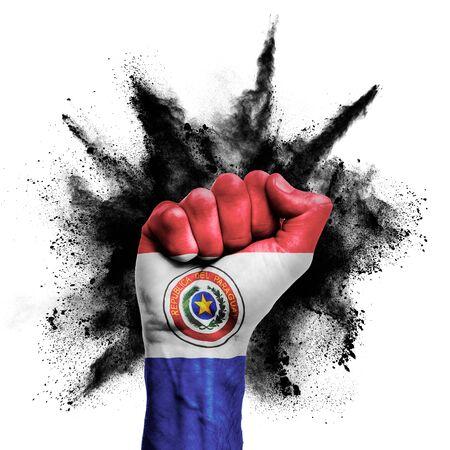 Paraguay raised fist with powder explosion, power, protest concept Banco de Imagens