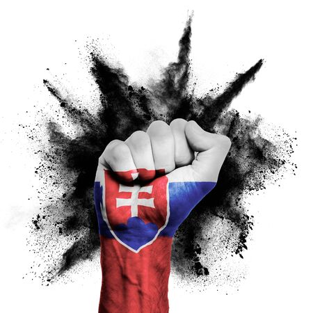 Slovakia raised fist with powder explosion, power, protest concept Stock Photo