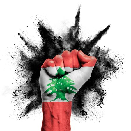 Lebanon raised fist with powder explosion, power, protest concept Stock Photo