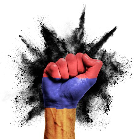 Armenia raised fist with powder explosion, power, protest concept Stock Photo