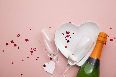 Romantic meal background. Heart shaped plate with champagne and glasses