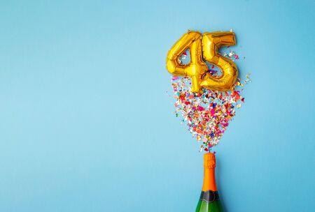45th anniversary champagne bottle balloon pop 스톡 콘텐츠