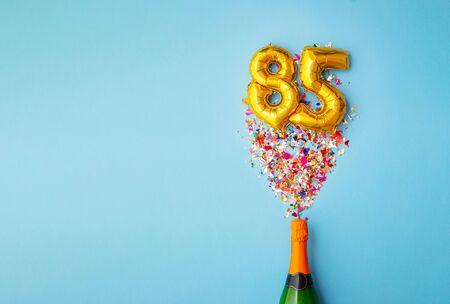85th anniversary champagne bottle balloon pop