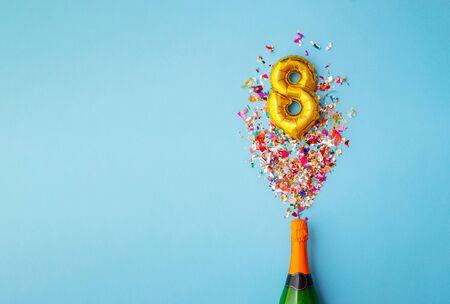 8th anniversary champagne bottle balloon pop