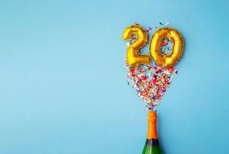 20th anniversary champagne bottle balloon pop Stock fotó