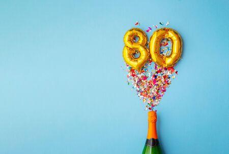 80th anniversary champagne bottle balloon pop