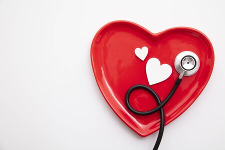 Red heart shape with a stethoscope. Healthy heart concept