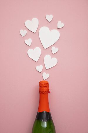 Romantic love hearts exploding from a bottle of champagne