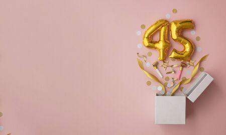 Number 45 birthday balloon celebration gift box lay flat explosion 스톡 콘텐츠