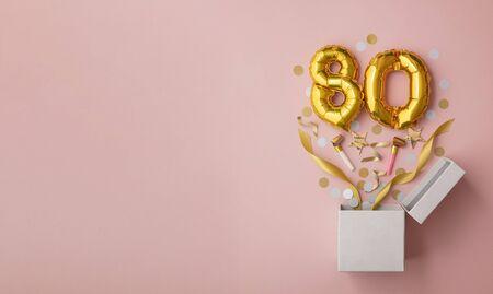 Number 80 birthday balloon celebration gift box lay flat explosion
