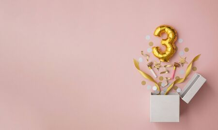 Number 3 birthday balloon celebration gift box lay flat explosion Archivio Fotografico